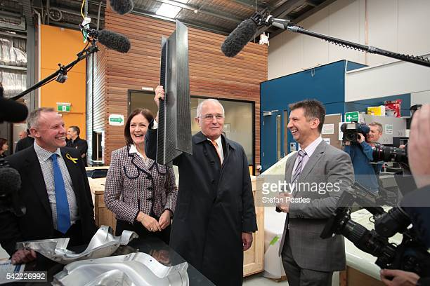 Prime Minister Malcolm Turnbull lifts a carbon fibre Ibeam at Quickstep Technologies an advanced composite manufacturer on June 23 2016 in Geelong...