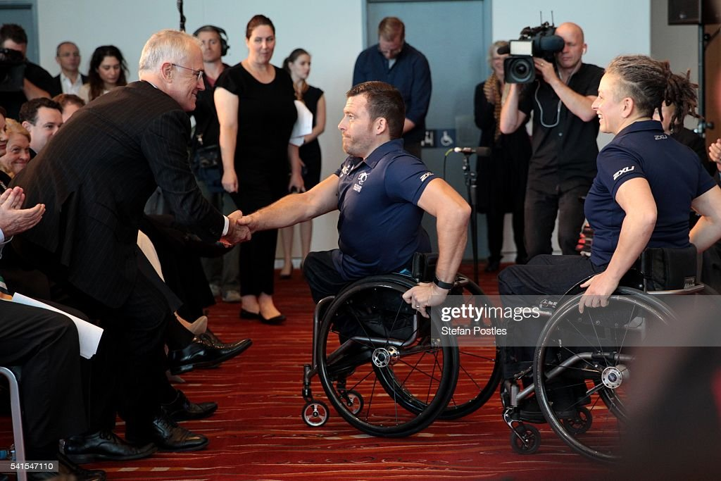 Prime Minister Malcolm Turnbull shakes hands with Australian Paralympian Kurt Fearnley during a launch at ANZ stadium on June 20, 2016 in Sydney, Australia. The Rio 2016 Paralympic Games take place from 7 - 18th September.