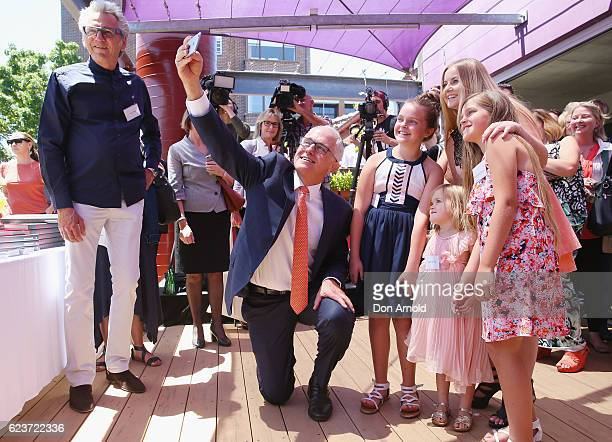 Prime Minister Malcolm Turnbull takes a selfie with some young girls during an event for Wayside The Iconic New Coffee Table Book Launch on November...