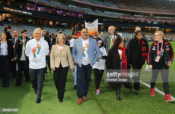Prime Minister Malcom Turnbull and his wife Lucy Turnbull join former Bombers legend Michael Long for The Long Walk before the round 10 AFL match...