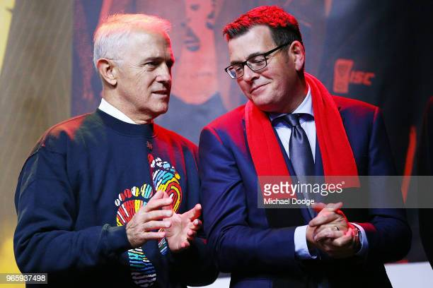 Prime Minister Malcom Turnbull talks with Victorian Premier Daniel Andrews during The Long Walk before during the round 11 AFL match between the...