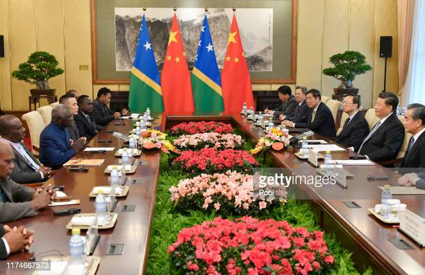 Prime Minister Manasseh Damukana Sogavare of the Solomon Islands meets with Chinese President Xi Jinping at the Diaoyutai State Guesthouse on October...