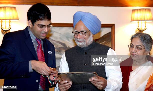 Prime Minister Manmohan Singh and his wife Gurcharan Kaur meet Viswanathan Anand in New Delhi Anand became the World Chess Champion on Sept 29 after...