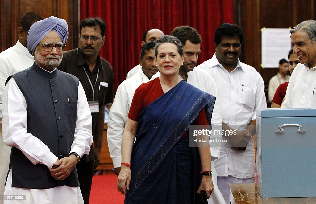 'NEW DELHI, INDIA - AUGUST 7: Prime Minister Manmohan Singh, Congress President Sonia Gandhi and Congress MP Rahul Gandhi after casting vote for the election of Vice President at Parliament house on August 7, 2012 in New Delhi, India. (Photo by Sunil Saxena/Hindustan Times via Getty Images)'