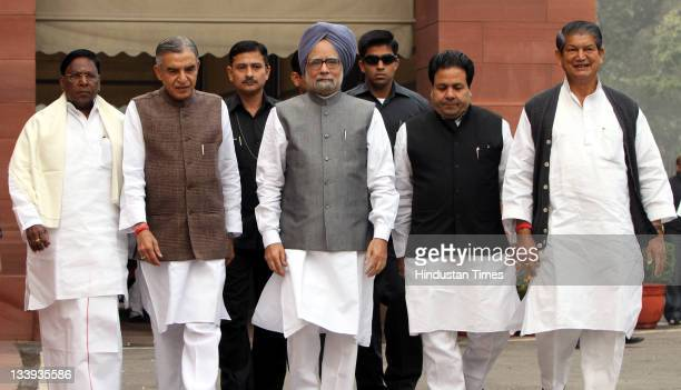 Prime Minister Manmohan Singh flanked by Parliamentary Affairs Minister Pawan K Bansal and Ministers of State V Narayanasamy , Rajiv Shukla and...