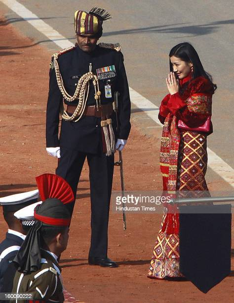 Prime Minister Manmohan Singh greeting Queen Jetsun Pema wife of chief guest King of Bhutan Jigme Khesar Namgyel Wangchuck on his arrival during the...