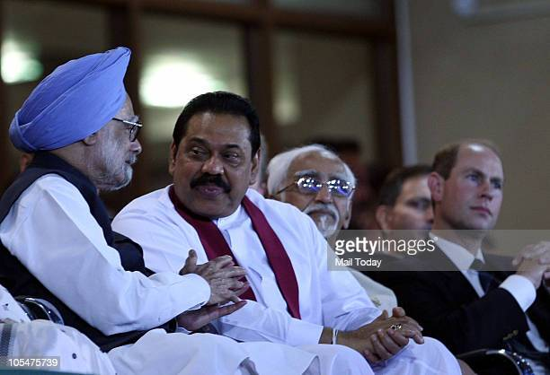 Prime Minister Manmohan Singh having a word with Sri Lankan President Mahinda Rajapaksa at the closing ceremony of the 19th Commonwealth games at...