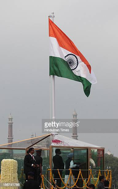 'NEW DELHI INDIA AUGUST 15 Prime Minister Manmohan Singh hoisting national flag at historic Red Fort on the 66th Independence Day on August 15 2012...