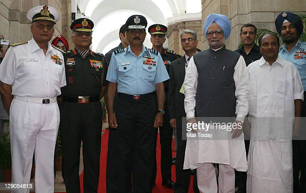 Prime Minister Manmohan Singh poses for a photo with Defence Minister AK Antony Chief of the Air Staff Air Chief Marshal NAK Browne Army chief...