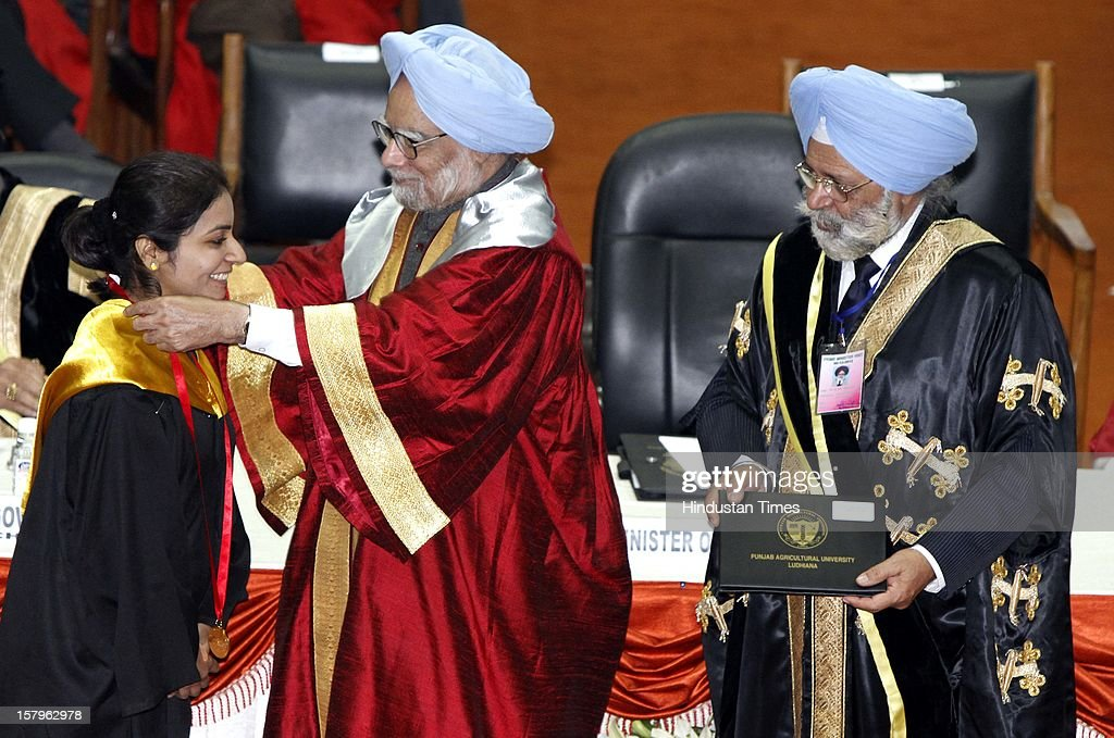 Prime Minister Manmohan Singh presenting the Gold medal to Pooja Manchanda one of the Gold Medalist during the Golden Jubilee convocation of Punjab Agriculture University on December 8, 2012 in Ludhiana, India. Also seen in the picture on extreme right Vice chancellor of PAU Dr BS Dhillon.