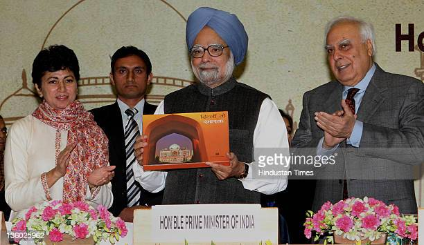 "Prime Minister Manmohan Singh released a book ""Dilli ke Smarak"" in the presence of Comunication and IT Minister Kapil Sibal and Culture Minister..."