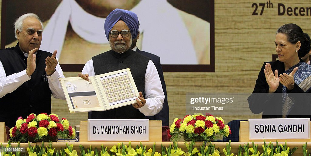 Prime Minister Manmohan Singh releases a commemorative stamp as Union Human Resource Development Minister Kapil Sibal (L) and Chairperson of the National Advisory Council Sonia Gandhi (R) looks on during a function to commemorate the 150th Birth Anniversary of Mahamana Madan Mohan Malaviya at Vigyan Bhawan on December 27, 2011 in New Delhi, India. A National Implementation Committee was formed under the chairmanship of Dr. Karan Singh to oversee the implementation of the various events aimed at promoting the ideals of Madan Mohan Malviya. Pandit Madan Mohan Malviya (1861-1946) was a prominent nationalist leader and served 4 times as the president of Indian National Congress. He also founded the Banaras Hindu University with Anne Besant.