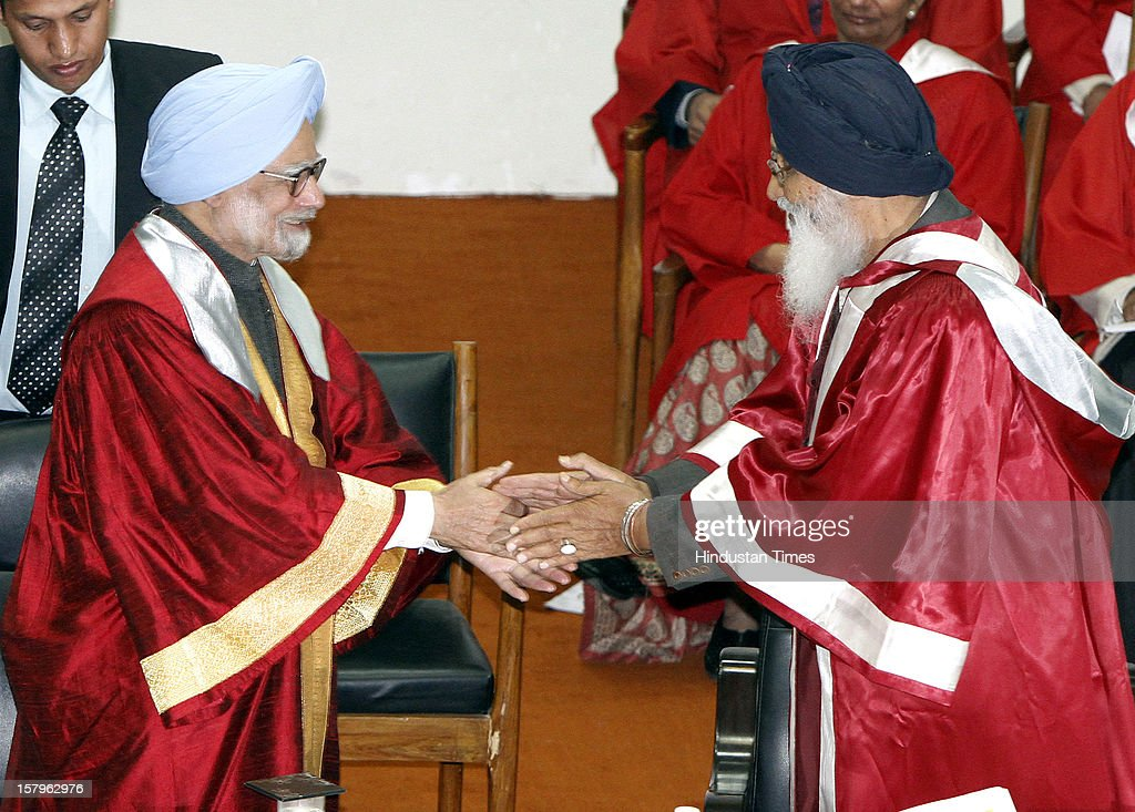 Prime Minister Manmohan Singh shaking hand with CM of Punjab Parkash Singh Badal during the Golden Jubilee convocation of Punjab Agriculture University on December 8, 2012 in Ludhiana, India.