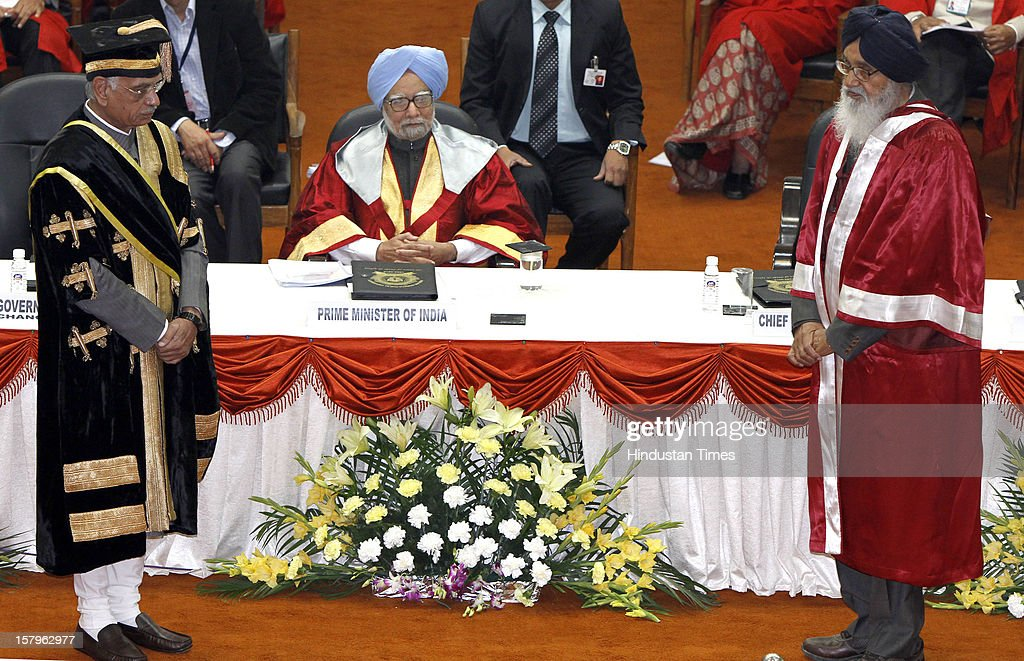 Prime Minister Manmohan Singh sitting in the center, Governor of Punjab and Chancellor of PAU Shivraj Patil (L) and CM of Punjab Parkash Singh Badal (R) during the Golden Jubilee convocation of Punjab Agriculture University on December 8, 2012 in Ludhiana, India.