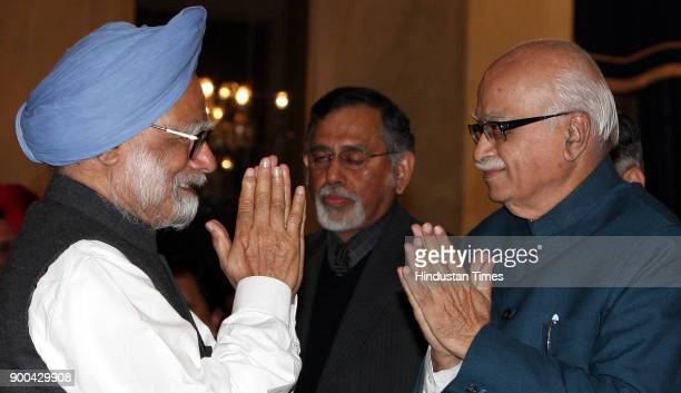 Prime Minister Manmohan Singh with BJP's senior leader L K Advani during oath taking ceremony of new Comptroller and Auditor General Vinod Rai at...
