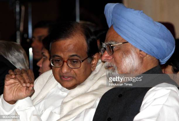 Prime Minister Manmohan Singh with Finance Minister P Chidambaram during oath taking ceremony of new Comptroller and Auditor General Vinod Rai at...