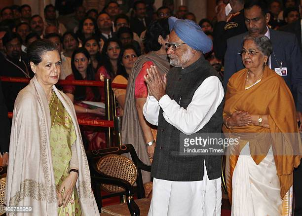 Prime Minister Manmohan Singh with his wife Gursharan Kaur greet UPA Chairperson and Congress President Sonia Gandhi at an awards ceremony at the...