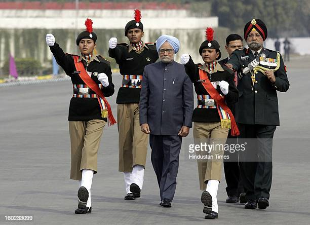 Prime Minister Manmohan Singh with NCC DG PS Bhalla escorts him to Guard of Honour at NCC PM's rally at Delhi Cantt Parade Ground on January 28 2013...