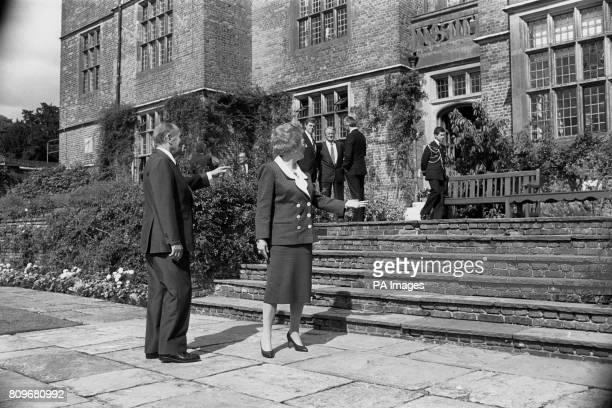 Prime Minister Margaret Thatcher and French President Francois Mitterrand indicate the flower borders at Chequers which they discussed when she...