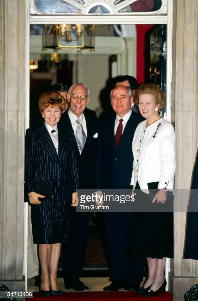 Prime Minister, Margaret Thatcher and her husband Denis Thatcher poses with visiting Russian President Mikhail Gorbachev and his wife Raisa...