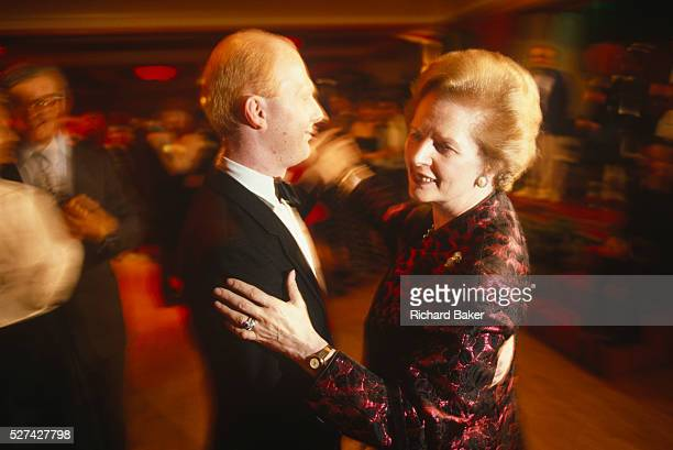 Prime Minister Margaret Thatcher is seen dancing with a Tory Party official during the 1990 Conservative Party conference in Blackpool Thatcher is...