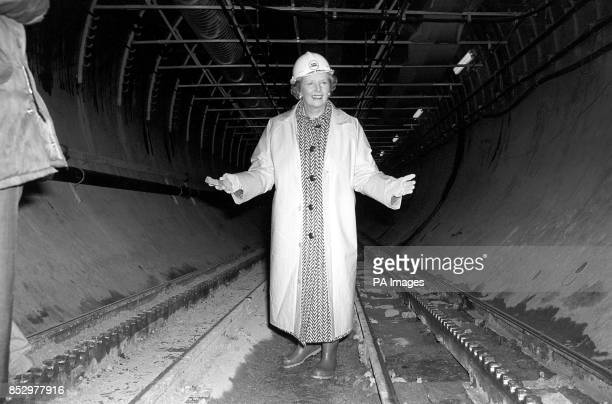 Prime Minister Margaret Thatcher, on her first visit to the 5 billion Channel Tunnel, near Dover, stands at the head of the service tunnel of the...