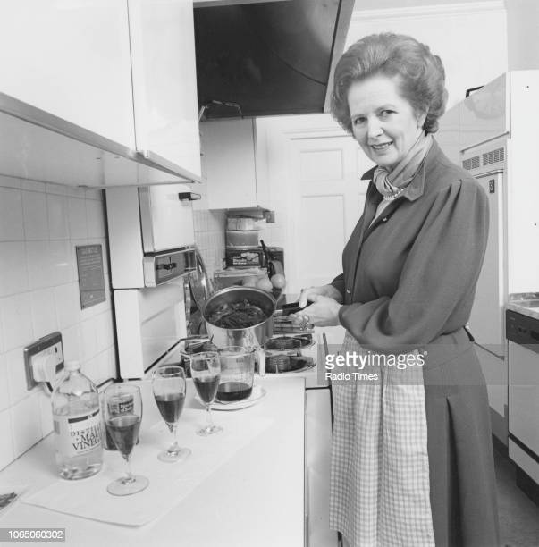 Prime Minister Margaret Thatcher pictured cooking red cabbage in the kitchen of 10 Downing Street, photographed for Radio Times in connection with...