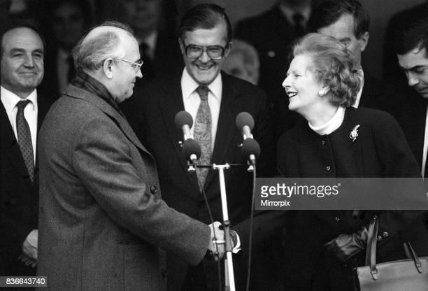 Prime Minister Margaret Thatcher shakes hands with Soviet leader President Mikhail Gorbachev at RAF base Brize Norton December 1987
