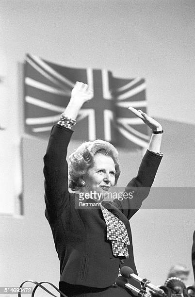 Prime Minister Margaret Thatcher stands with her arms raised at a Conservative Party conference in Brighton. The IRA tried to assassinate her with a...