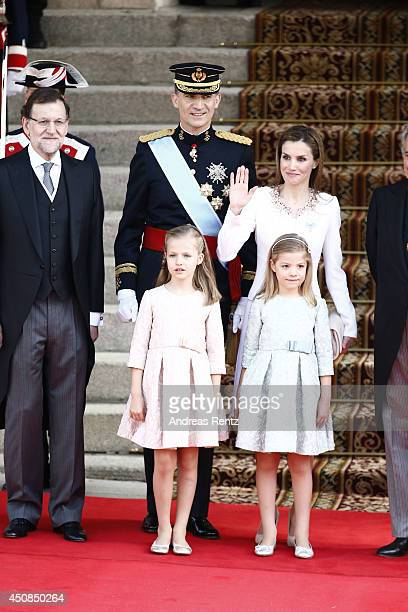 Prime Minister Mariano Rajoy stands with King Felipe VI of Spain and Queen Letizia of Spain Princess Leonor Princess of Asturias and Princess Sofia...