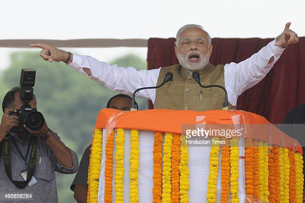 Prime Minister Narendra Modi addresses a public meeting during the foundation stone laying ceremony of the Eastern Peripheral Expressway/Western...