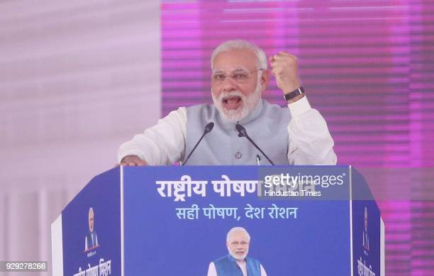 Prime Minister Narendra Modi addresses at a public rally at the launch of National Nutrition Mission on March 8 2018 in Jhunjhunu India Prime...