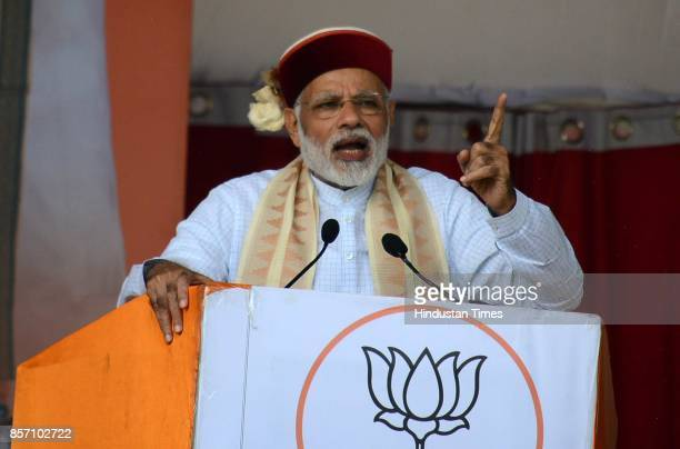 Prime Minister Narendra Modi addresses during a BJP Abhar Rally at Luhnu ground on October 3 2017 in Bilaspur India PM Modi who was in Bilaspur to...