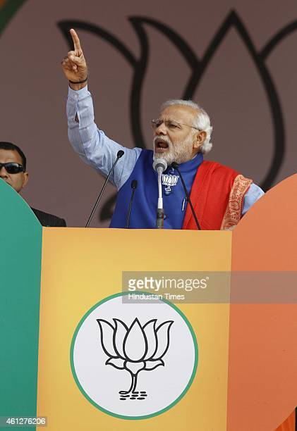 Prime Minister Narendra Modi addresses during the 'Abhinandan rally' at Ramlila Maidan on January 10 2015 in New Delhi India Modi appeals the people...