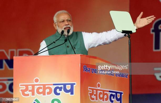 Prime Minister Narendra Modi addresses his supporters during Sankalp Rally at Gandhi Maidan on March 3 2019 in Patna India Modi while sounding the...