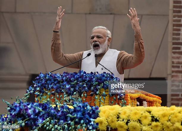 Prime Minister Narendra Modi addresses the crowd during the flagging off ceremony of 'Run for Unity' on the 142nd birth anniversary of Sardar...