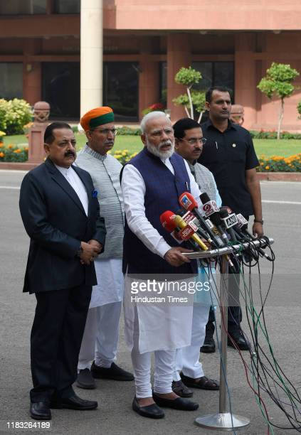 Prime Minister Narendra Modi addresses the media on his arrival to attend first day of winter session of Parliament in the presence of Union...