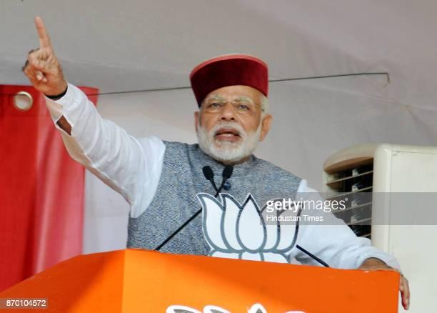 Prime Minister Narendra Modi addressing crowd during a BJP Parivartan Rally at Rait on November 4 2017 in Dharamsala India PM Modi hinted at a...
