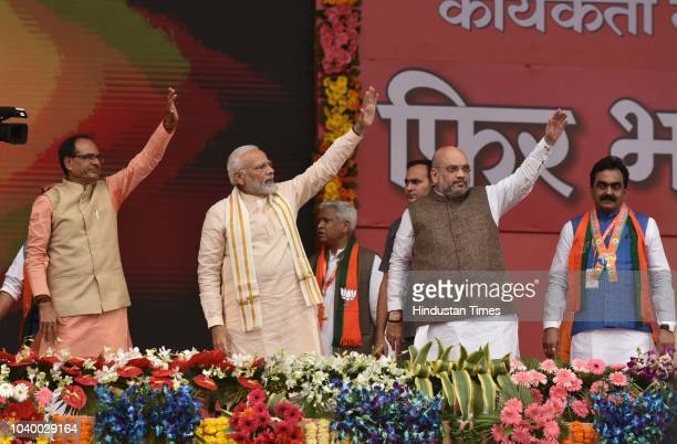 BJP workers wearing masks of Prime Minister Narendra Modi and party president Amit Shah during the BJP party workers conclave called Karyakarta...