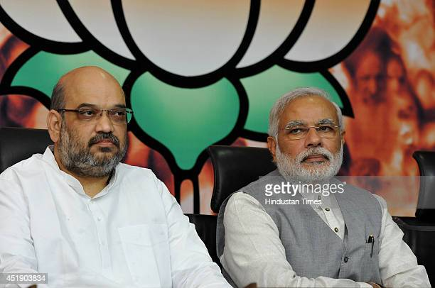 Prime Minister Narendra Modi along with newly appointed BJP President Amit Shah at the BJP headquarters on July 9 2014 in New Delhi India A close...
