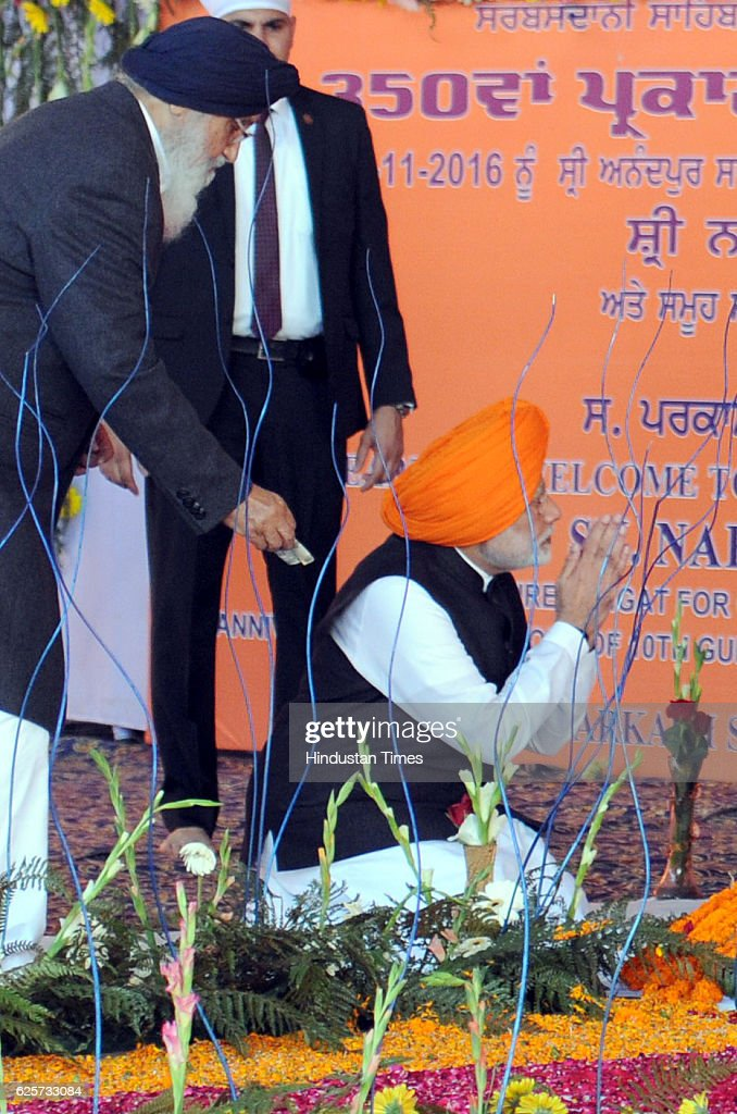Prime Minister Narendra Modi along with Prakash Singh Badal CM Punjab as Badal giving 100 rupee to Modi during a function to mark 350th Birth...