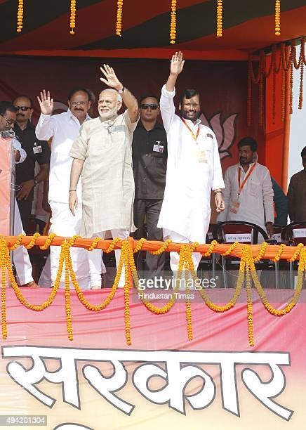 Prime Minister Narendra Modi along with Union Minister of Urban Development Housing and Urban Poverty Alleviation and Parliamentary Affairs Venkaiah...