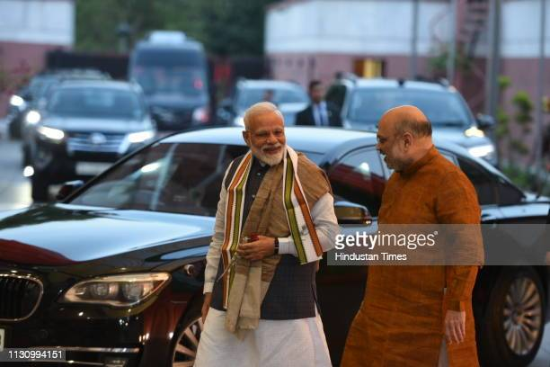 Prime Minister Narendra Modi and Bharatiya Janata Party chief Amit Shah arrive to attend the central election committee meeting to discuss key issues...