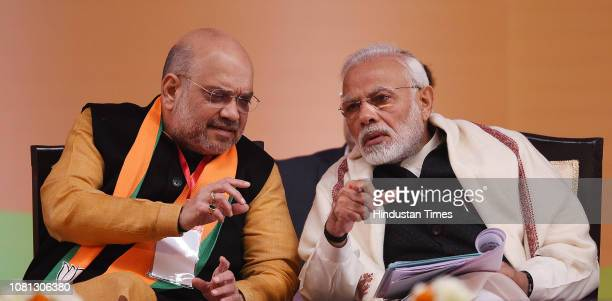 Prime Minister Narendra Modi and BJP National President Amit Shah on the second day of BJP National Executive Meet at Ramlila Maidan on January 12...