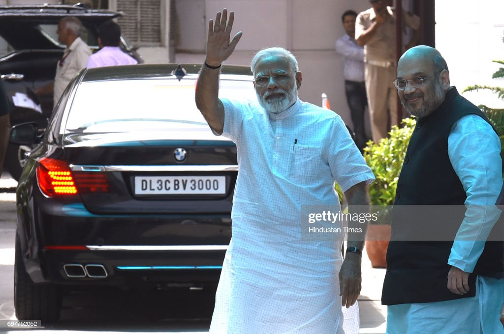 Prime Minister Narendra Modi and BJP National President Amit Shah wave after the party's Parliamentary Board meeting to announce their Presidential candidate, on June 19, 2017 in New Delhi, India. Bihar Governor Ramnath Kovind was named as NDA's nominee for presidential poll.