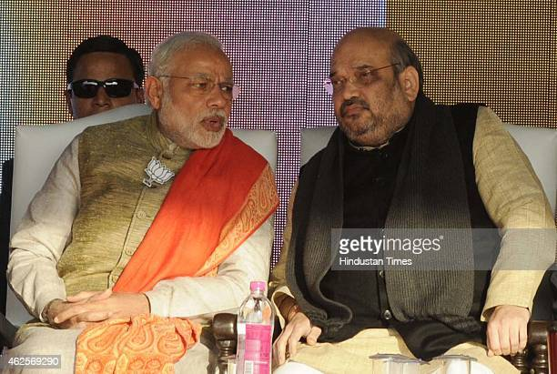 Prime Minister Narendra Modi and BJP president Amit Shah during an election rally at Karkardooma on January 31 2015 in New Delhi India Modi accused...