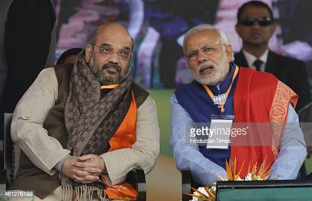 Prime Minister Narendra Modi and BJP President Amit Shah during the 'Abhinandan rally' at Ramlila Maidan, on January 10, 2015 in New Delhi, India....