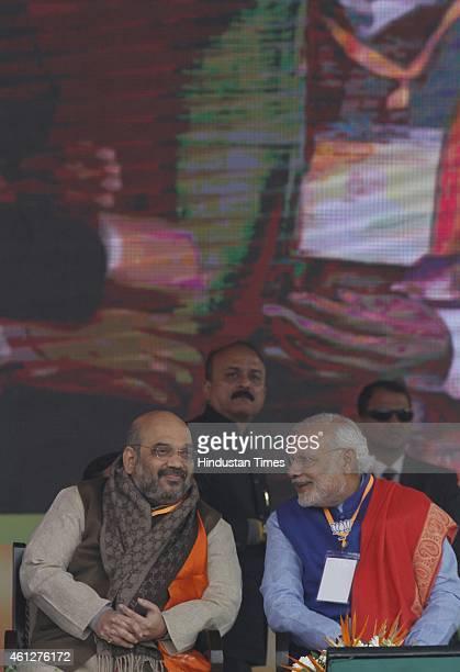 Prime Minister Narendra Modi and BJP President Amit Shah during the 'Abhinandan rally' at Ramlila Maidan on January 10 2015 in New Delhi India Modi...