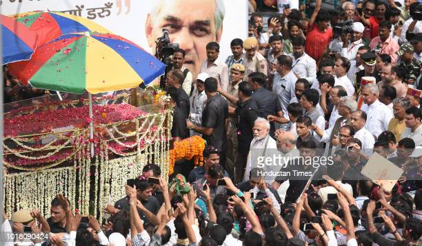 Prime Minister Narendra Modi and BJP President Amit Shah take part in the funeral procession of former Prime Minister Atal Bihari Vajpayee at ITO...