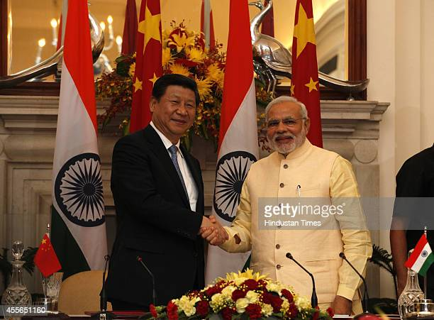 Prime Minister Narendra Modi and Chinese President Xi Jinping shake hands at the agreement signing ceremony at Hyderabad House on September 18 2014...